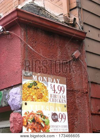 Old Building Featuring an Advertisement for Food