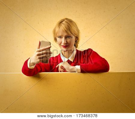Blonde woman doing a selfie