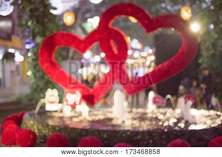 Two Red Valentines Hearts Against Blurred Bright Background.