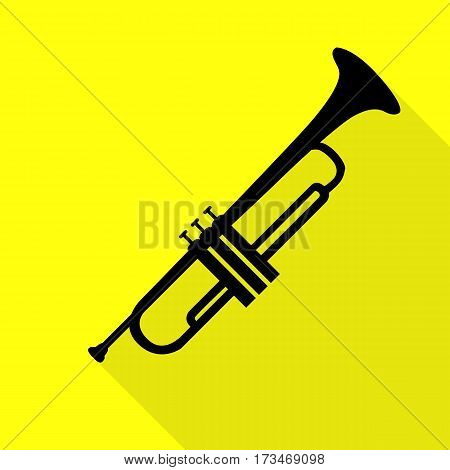 Musical instrument Trumpet sign. Black icon with flat style shadow path on yellow background.