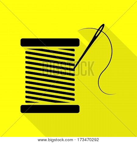 Thread with needle sign illustration. Black icon with flat style shadow path on yellow background.