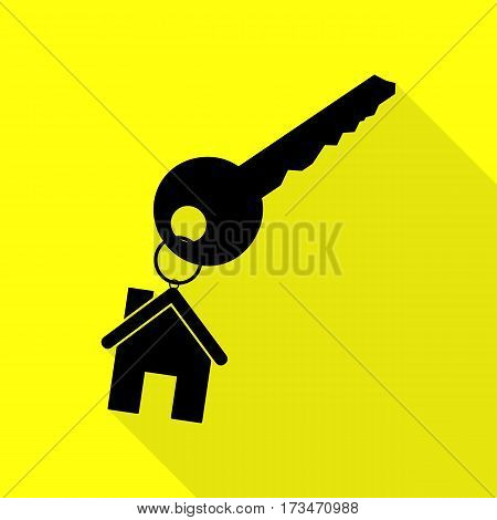 key with keychain as an house sign. Black icon with flat style shadow path on yellow background.