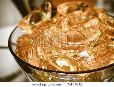 Many of yellow crystal in chinese gold bar shape in glass with color filter effect