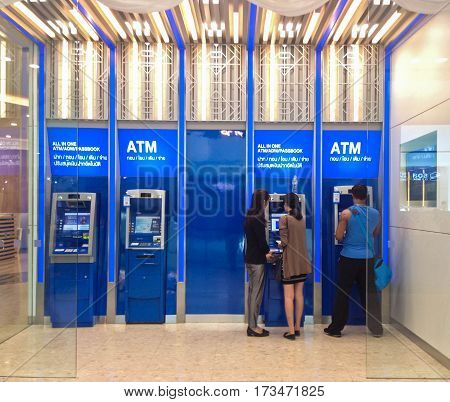 BANGKOK, THAILAND-FEBRUARY 8,2017 : Blur or Defocus Background of People use Banking Machine or ATM(Automatic Teller Machine) to Deposit, Withdraw and Transfer Money.