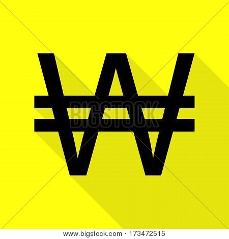 Won sign. Black icon with flat style shadow path on yellow background.