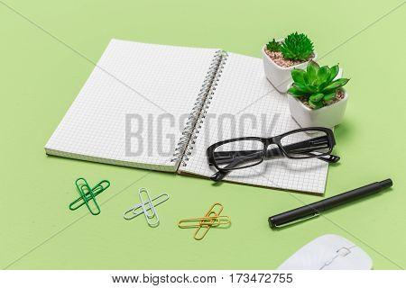 Close Up Office Desk Paper Book With Grid And Business Object, Shot From Above.