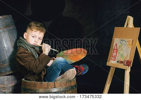 Boy artist with palette and brushes.Retro portrait