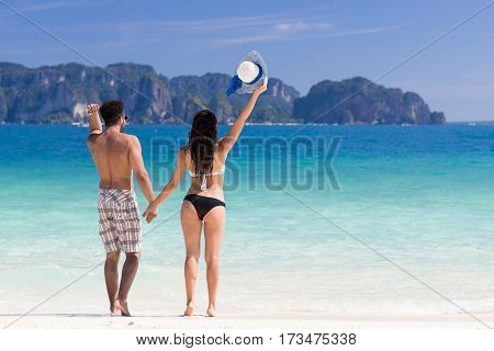Young People On Beach Summer Vacation, Couple Raised hands Happy Seaside Blue Water Sea Ocean Holiday Travel