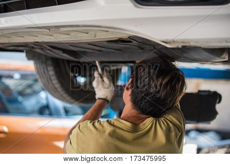 Car Maintenance Servicing Mechanic Pouring New Oil