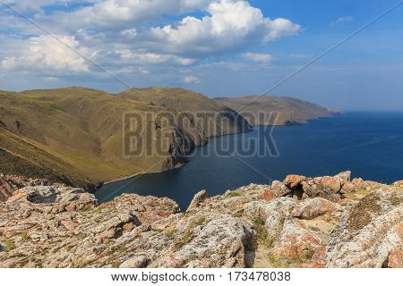 View from the rock on cape and water space of lake Baikal