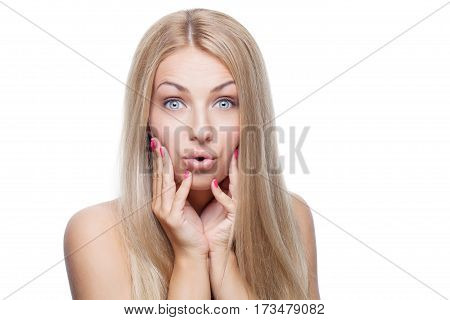 Beautiful young woman with natural makeup and silky blond hair. Surprised expression. Beauty shot isolated on white background. Copy space.