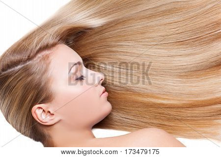 Beautiful young woman with natural makeup and silky blond hair. Beauty shot isolated on white background. Copy space.