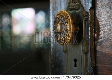 Scenery of the wooden door handle and key hole of the room
