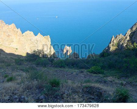 Crimean landscape of extinct Karadag volcano. Golden gate rock