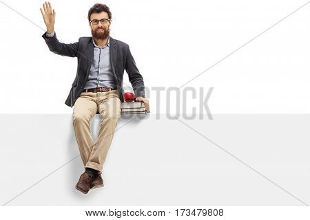 Male teacher sitting on a panel and waving isolated on white background