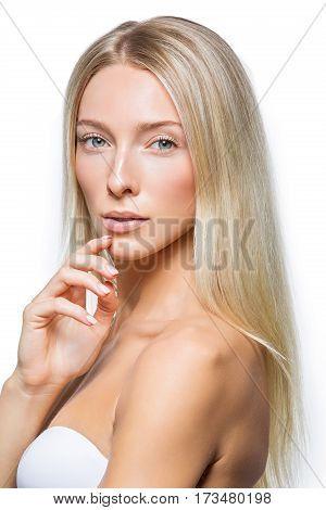 Beautiful blonde young woman with straight long hair and natural make-up. Isolated on white background. Copy space.