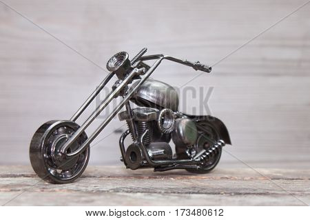 Cool gift Bike various metal parts on wooden background