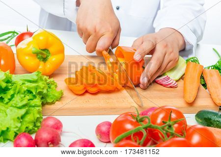 Preparation Of Cutting Vegetables For Salad, Close Up Hands Of Chef With Knife