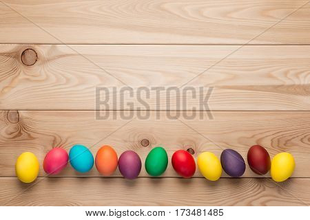 Chicken Easter Eggs At The Bottom Of The Frame, A Wooden Background Space