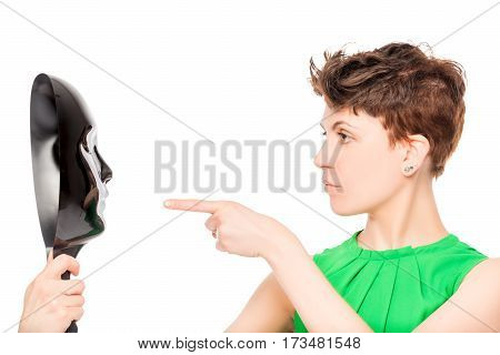 Beautiful Girl Pointing At The Black Mask Isolated On White Background