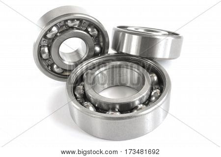 Three different bearings on the white background.