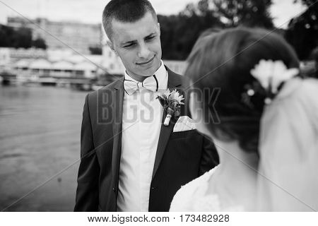 Close Up Portrait Of Charming Wedding Couple Hugging On Pier Of The Dock. Black And White Photo.