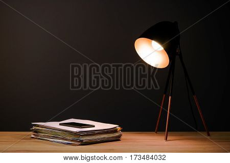 Office desk with lamp ring binders and mobile phone