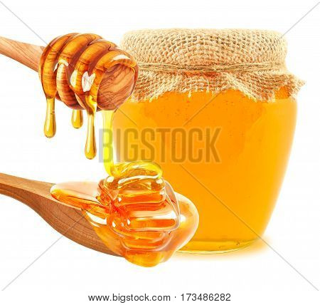 dripping honey and jar of honey isolated on white background