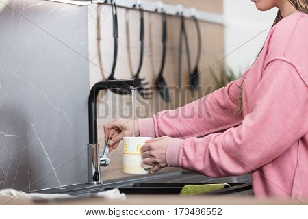 Woman's Hands Pouring Water In Her Kitchen