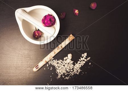 Cosmetics And Flowers On A Black Background