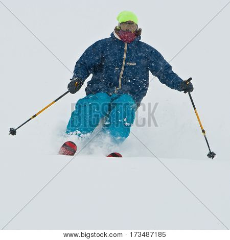 Young man skiing in the snowstorm. Mountains of Georgia