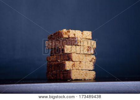 Pile of traditional Dutch cake Ontbijtkoek on dark blue background