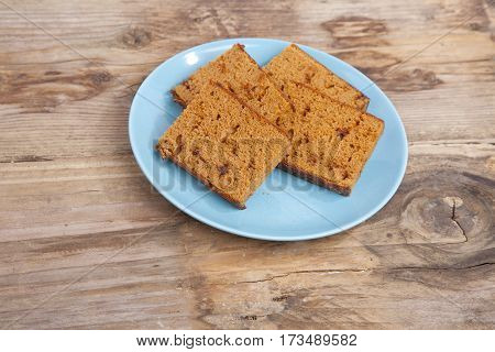 Traditional Dutch cake Ontbijtkoek on wooden background
