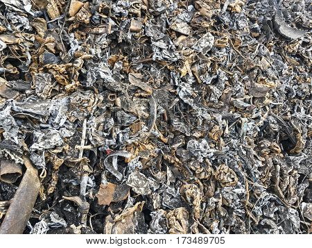 pieces of iron parts from scrapped cars and other metal after crushing and separation from other metals as a background