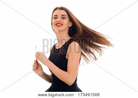 young smiling girl with red lipstick and black dress which fly away hair isolated on white background