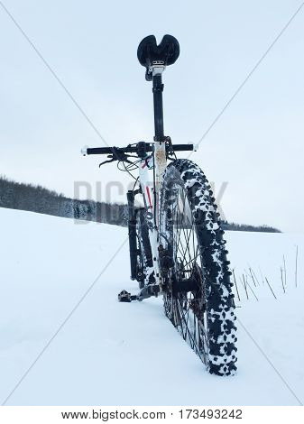 Mountain Bike Stay In Powder Snow. Deep Snowdrift. Rear Wheel Detail.