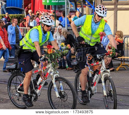 Zurich, Switzerland - 13 April, 2015: police bicyclists on Bahnhofstrasse street during the Sechselauten parade. The Sechselauten is a traditional spring holiday in the city of Zurich.