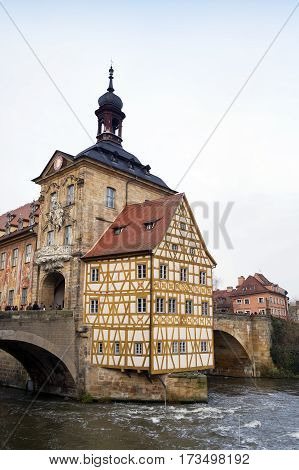 BAMBERG GERMANY - DECEMBER 05 2015: Old Town Hall (Altes Rathaus) and Obere bridge in Bamberg Germany