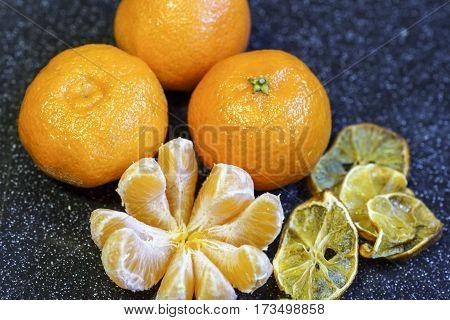 Mandarin Orange Fruit, Peeled On A Black Background