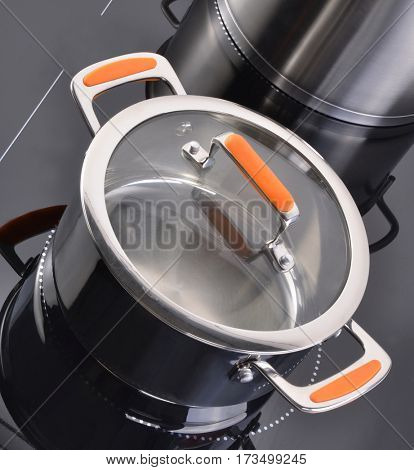 Modern kitchen, Induction cooker and kitchen utensils.