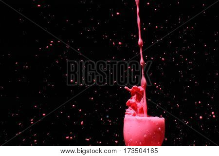 milk splash background / Milk is a pale liquid produced by the mammary glands of mammals. It is the primary source of nutrition for infant mammals