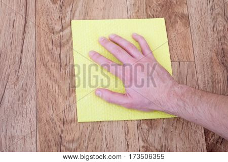 A Hand Of Man Leaning A Parquet Floor