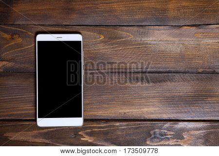 White Mobile Phone On A Wooden Background