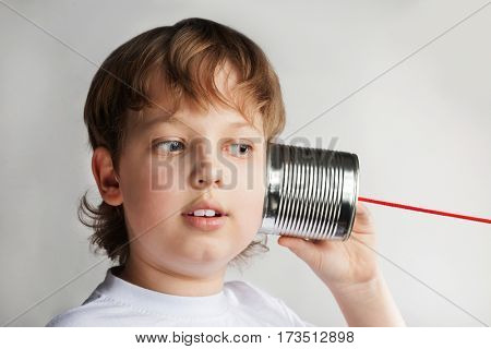 happy boy play in the tin can phone