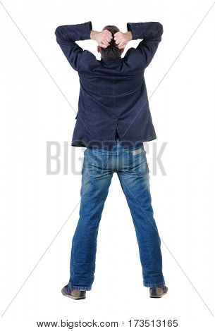 angry young man. Rear view. isolated over white