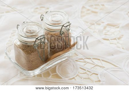 Brown Sugar in glass bottle with wooded spoon on the table in vintage coffe shop