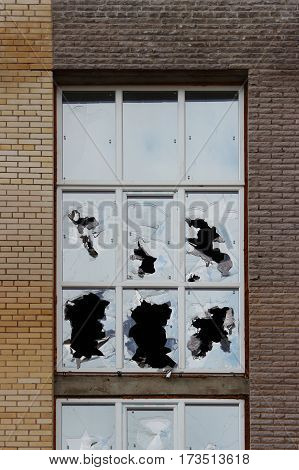 Vandals smashed the glass of windows of the an unfinished shopping mall, which was left without protection