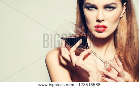 Pretty Girl With Red Lips Drinking Wine From Glass