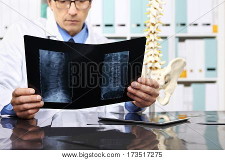 Radiologist doctor checking xray healthcare medical and radiology concept