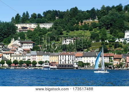 People Sailing On A Sailboat Front Of Orta